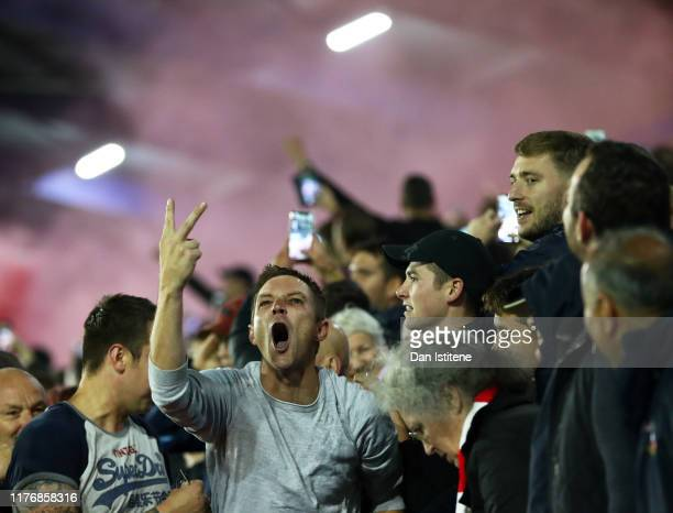 Fans of Southampton react in the crowd during the Carabao Cup Third Round match between Portsmouth and Southampton at Fratton Park on September 24,...