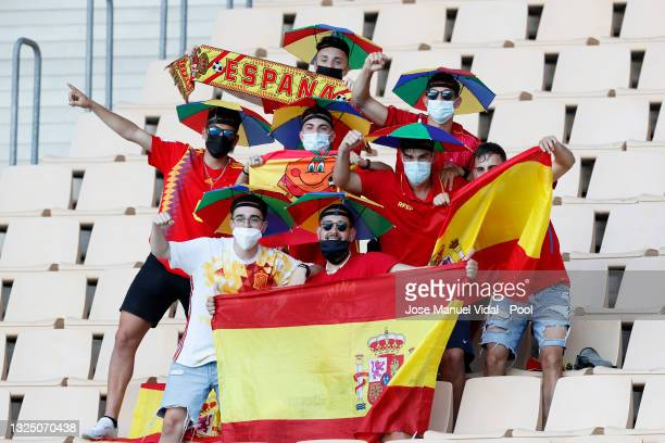 Fans of Spain waving flags show their support prior to the UEFA Euro 2020 Championship Group E match between Slovakia and Spain at Estadio La Cartuja...
