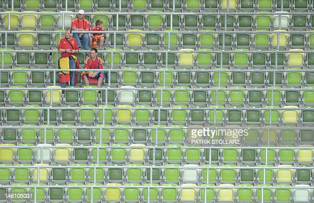 Fans of Spain's national football team wait in the grandstand prior to the Euro 2012 championships football match Spain vs Italy on June 10 2012 at...