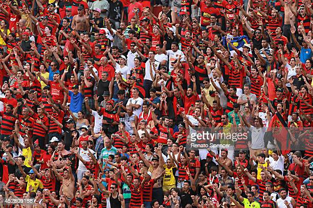 Fans of Sport Recife cheer before a match between Sport Recife and Atletico MG as part of Brasileirao Series A 2014 at Ilha do Retiro Stadium on July...