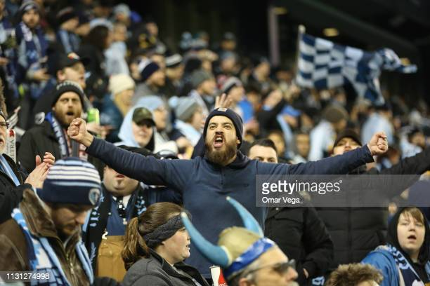 Fans of Sporting Kansas City celebrate during the match between Sporting Kansas City and Toluca as part of the CONCACAF Champions League 2019 at...