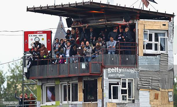 Fans of St. Pauli celebrate after Rouwen Hennings of St. Pauli scored his team's first goal during the Bundesliga match between FC St. Pauli and...