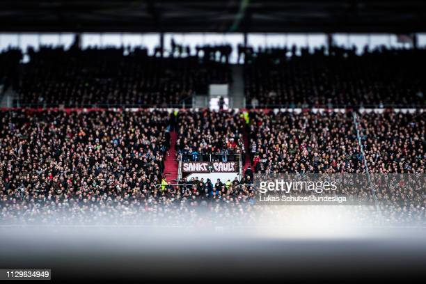 Fans of St. Pauli support their team during the 2. Bundesliga match between FC St. Pauli and Hamburger SV at Millerntor Stadium on March 10, 2019 in...