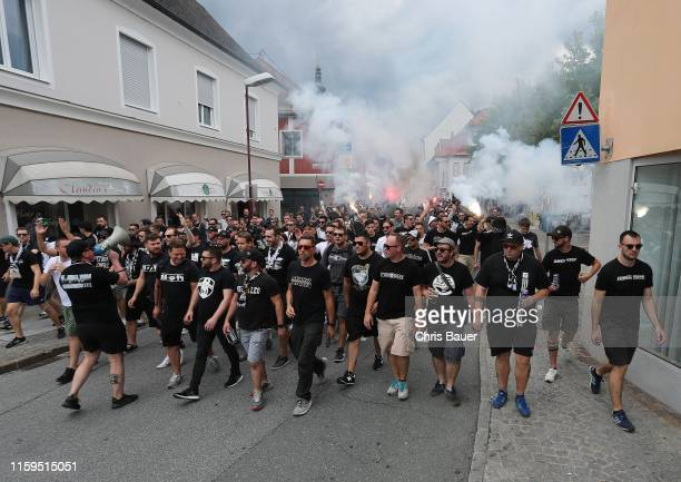 August 04: Fans of Sturm Graz walking to the stadium with pyrotechnic before the tipico Bundesliga match between RZ Pellets WAC and SK Punitgamer...