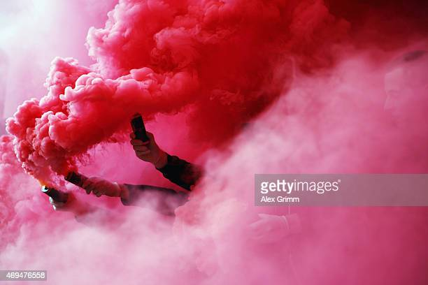 Fans of Stuttgart burn flares prior to the Bundesliga match between VfB Stuttgart and SV Werder Bremen at MercedesBenz Arena on April 12 2015 in...