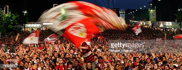 Fans of Stuttgart celebrate as a goal is scored by their team at a public viewing area next to the Brandenburg Gate during the DFB German Cup Final...