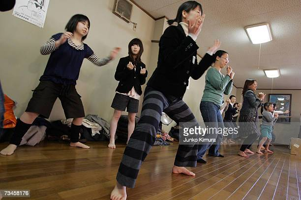 """Fans of sumo wrestling participate in a sumo exercise class during a """"Sumo Diet Campaign"""" event at the Musashigawa Sumo Stable on March 1, 2007 in..."""
