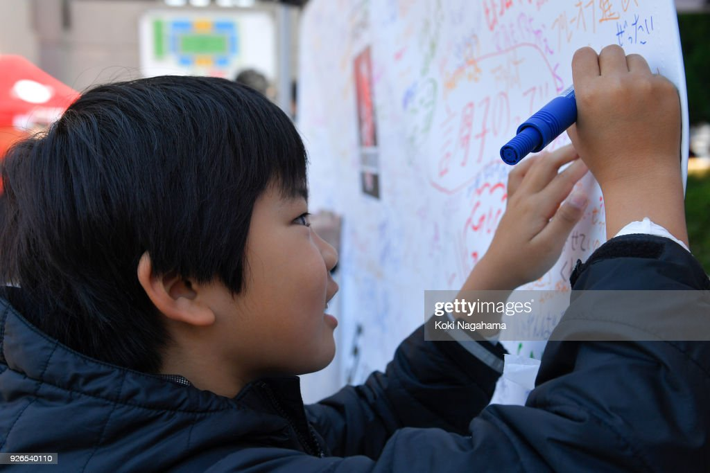 Fans of Sunwolves write on the message board prior to the Super Rugby round 3 match between Sunwolves and Rebels at the Prince Chichibu Memorial Ground on March 3, 2018 in Tokyo, Japan.