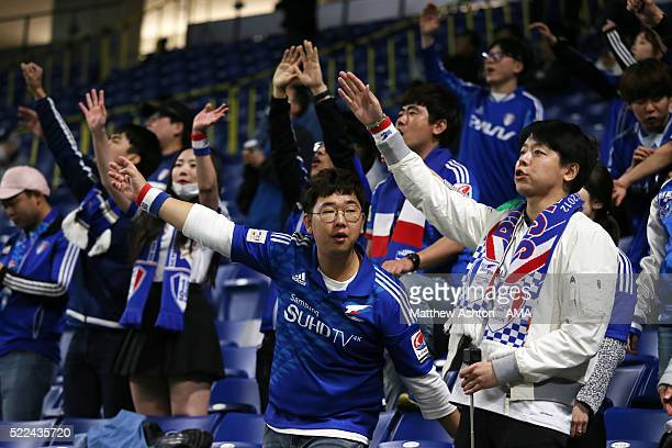 Fans of Suwon Samsung Bluewings cheer during the AFC Champions League Group G match between Gamba Osaka and Suwon Samsung Bluewings at Suita City...