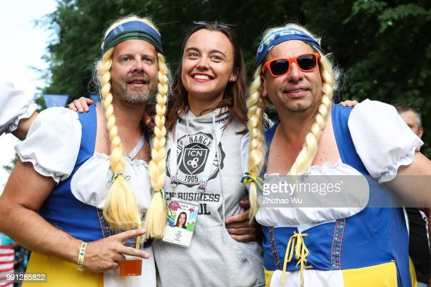 Fans of Sweden cheer before the 2018 FIFA World Cup Russia Round of 16 match between 1st Group F and 2nd Group E at Saint Petersburg Stadium on July...