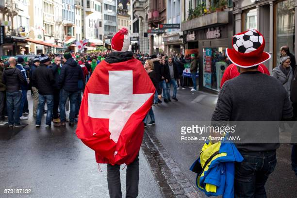 Fans of Switzerland in the centre of Basel prior to the FIFA 2018 World Cup Qualifier PlayOff Second Leg between Switzerland and Northern Ireland at...