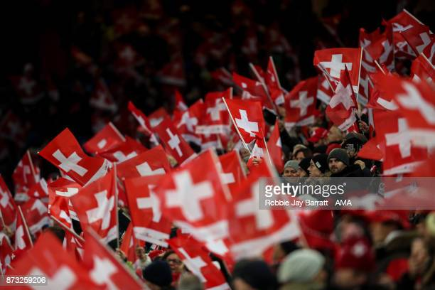 Fans of Switzerland wave flags during the FIFA 2018 World Cup Qualifier PlayOff Second Leg between Switzerland and Northern Ireland at St JakobPark...