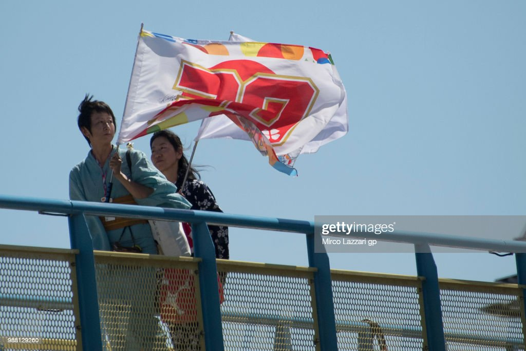 Fans of Takaaki Nakagami of Japan and LCR Honda Idemitsu walk in paddock during the Qualifying practice during the MotoGP Netherlands - Qualifying on June 30, 2018 in Assen, Netherlands.