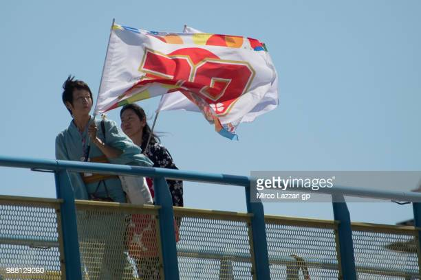 Fans of Takaaki Nakagami of Japan and LCR Honda Idemitsu walk in paddock during the Qualifying practice during the MotoGP Netherlands Qualifying on...