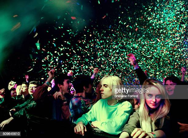 Fans of Tame Impala enjoy the confetti cannons while the band perform at Manchester Arena on February 11 2016 in Manchester England