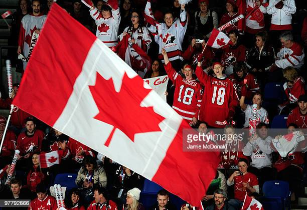 Fans of Team Canada cheer as a large flag is waved in the air during the Ice Sledge Hockey Preliminary Round Group B Game between Norway and Canada...