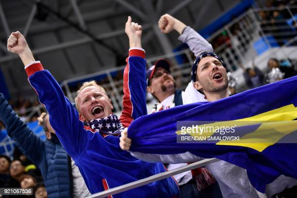 TOPSHOT Fans of team USA cheer during the second period of the men's quarterfinals playoffs ice hockey match between the United States and Slovakia...