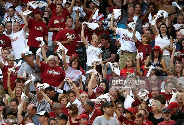 Fans of the Arizona Diamondbacks cheer before the start of Game One of the National League Championship Series against the Colorado Rockies at Chase...