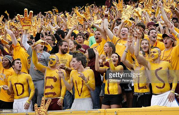 Fans of the Arizona State Sun Devils cheer during the college football game against the Arizona Wildcats at Sun Devil Stadium on November 28 2009 in...