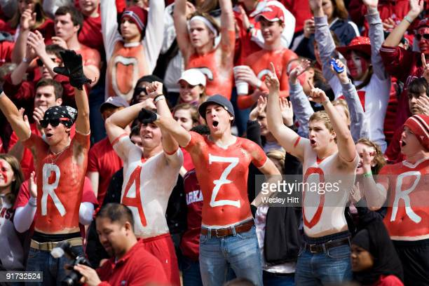 Fans of the Arkansas Razorbacks cheer on their team during a game against the Auburn Tigers at Donald W Reynolds Stadium on October 10 2009 in...