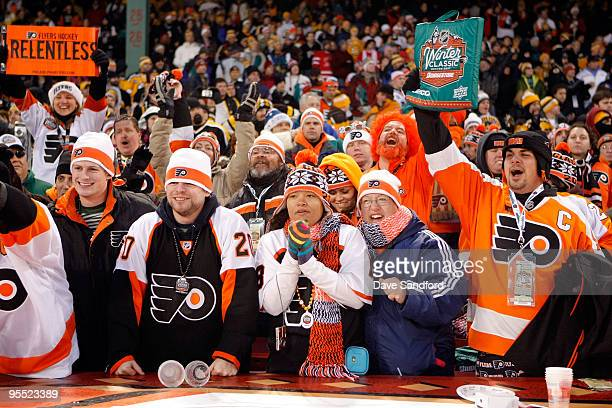 Fans of the Boston Bruins and the Philadelphia Flyers enjoy the action during the 2010 Bridgestone NHL Winter Classic at Fenway Park on January 1...