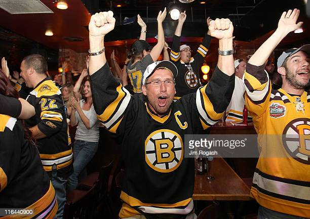 Fans of the Boston Bruins react to a goal at Hurricane O'Reilly's Bar during Game Seven of the 2011 Stanley Cup Final against the Vancouver Canucks...