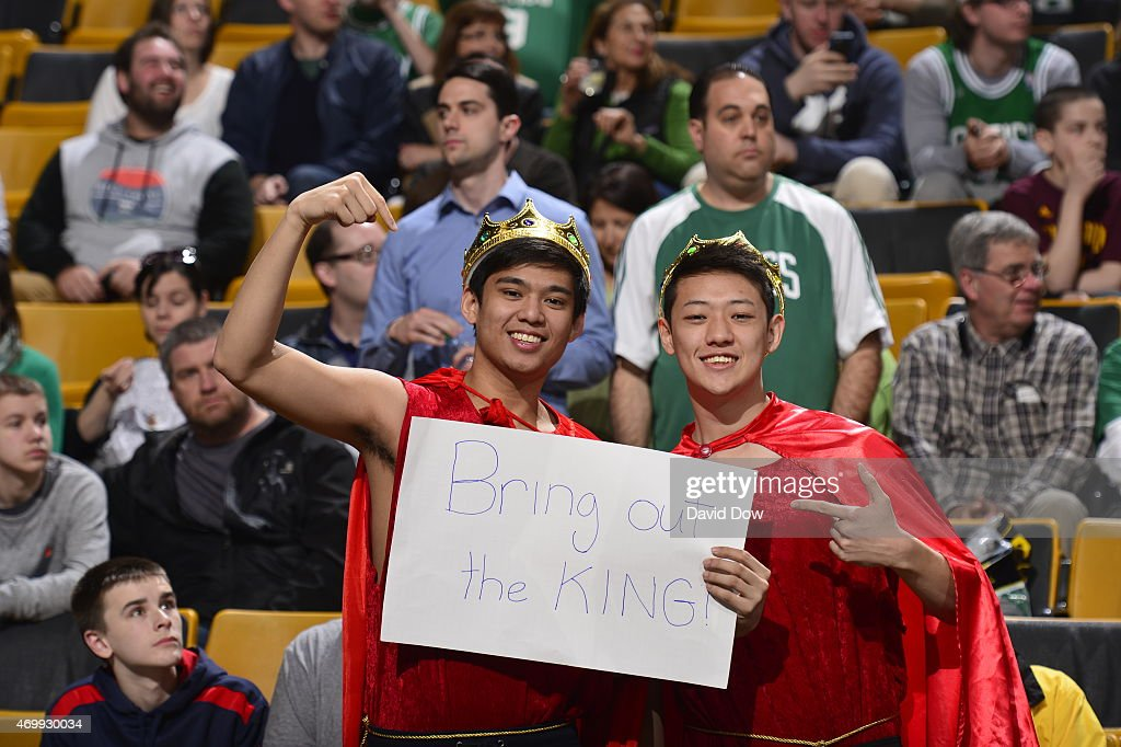 Fans of the Boston Celtics pose for a picture during a game against the Cleveland Cavaliers on April 12, 2015 at the TD Garden in Boston, Massachusetts.