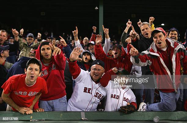 Fans of the Boston Red Sox celebrate after defeating the Tampa Bay Rays in game five of the American League Championship Series during the 2008 MLB...