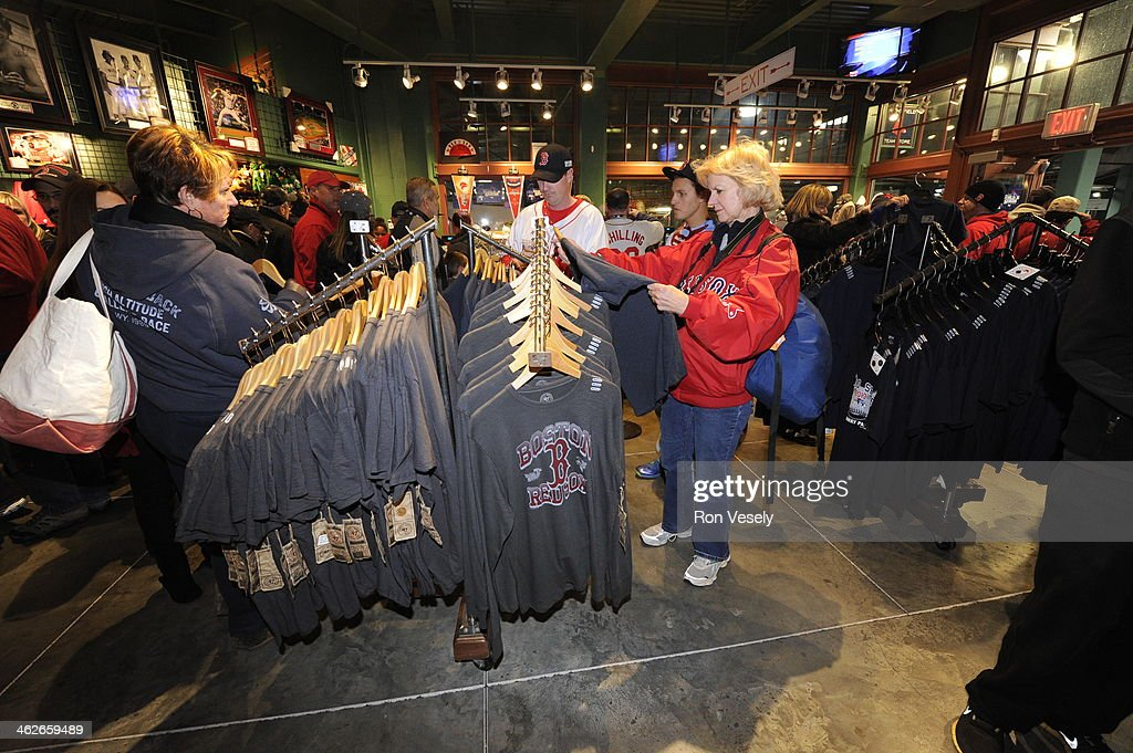 Fans of the Boston Red Sox shop for merchandise before Game