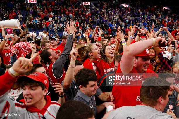 Fans of the Bradley Braves rush on to the court to celebrate after beating the Northern Iowa Panthers during the final game of the MVC Basketball...