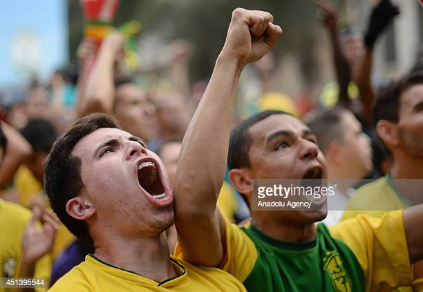 Fans of the Brazil national soccer team watch the 2014 World Cup round of 16 match between Brazil and Chile on a giant screen in Vale do Anhangabau...