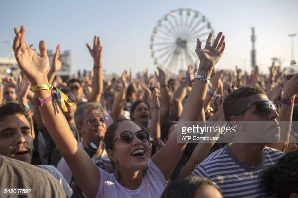Fans of the Brazilian band Blitz attend a concert at the Rock in Rio Festival in the Olympic Park Rio de Janeiro Brazil on September 16 2017 Running...