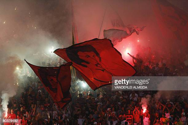 Fans of the Brazilian football team Flamengo wave flags with images of former team players, on March 19 before a Libertadores Cup match against...