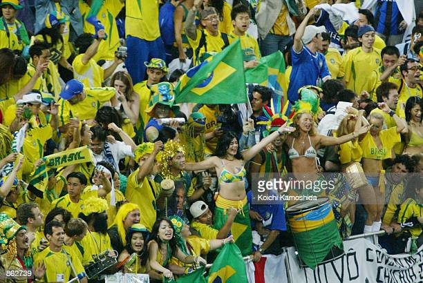Fans of the Brazilian national soccer celebrate Brazil's victory over Turkey in a semifinal World Cup match June 26 2002 in Saitama Stadium in...