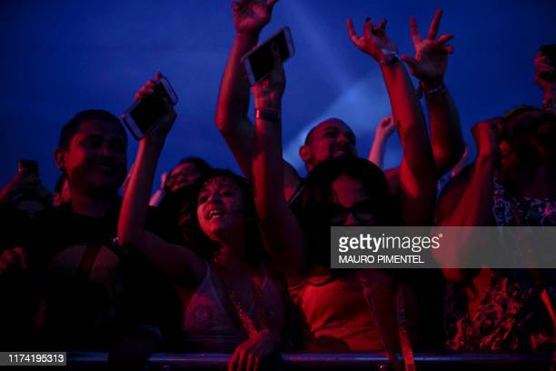 Fans of the Brazilian rock band Paralamas do Sucesso enjoy their concert during the last day of the Rock in Rio music festival at the Olympic Park in...