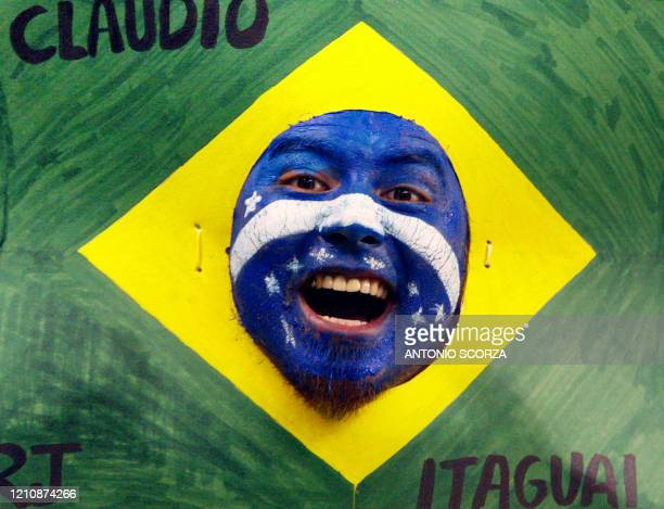 Fans of the Brazilian soccer team cheers in Saitama Stadium, Japan, 26 June before the start of the Brazil-Turkey semi-final match of the FIFA 2002...