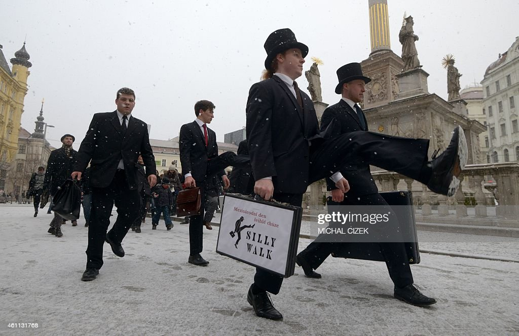 Fans of the British comedy group Monty Python perform their skills during the International Silly Walk Day on January 7, 2015 in Brno, Czech Republic. Around 50 participants in costumes presented the Silly Walk, based on a sketch from the Monty Python troupe.