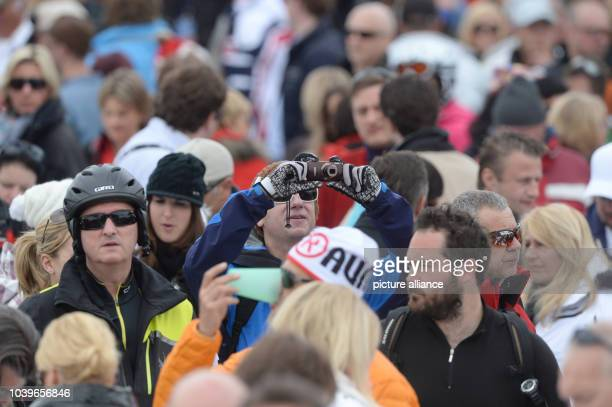 Fans of the British rock group 'Deep Purple' stand in front of the stage during an Open Air concert in Ischgl Tyrol Austria 30 April 2013 Photo Felix...