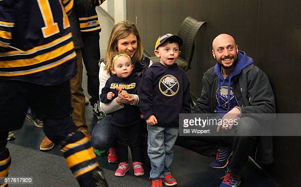 Fans of the Buffalo Sabres watch players head to the ice before the NHL game against the Winnipeg Jets on March 26 2016 at the First Niagara Center...