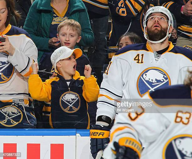 Fans of the Buffalo Sabres watch them skate before a game against the Pittsburgh Penguins on April 11 2015 at the First Niagara Center in Buffalo New...