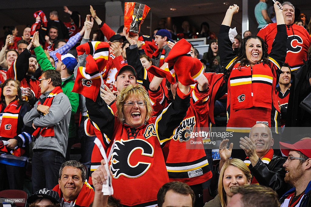 Fans of the Calgary Flames celebrate a goal against the Winnipeg Jets during an NHL game at Scotiabank Saddledome on April 11, 2014 in Calgary, Alberta, Canada. The Jets defeated the Flames 5-3.