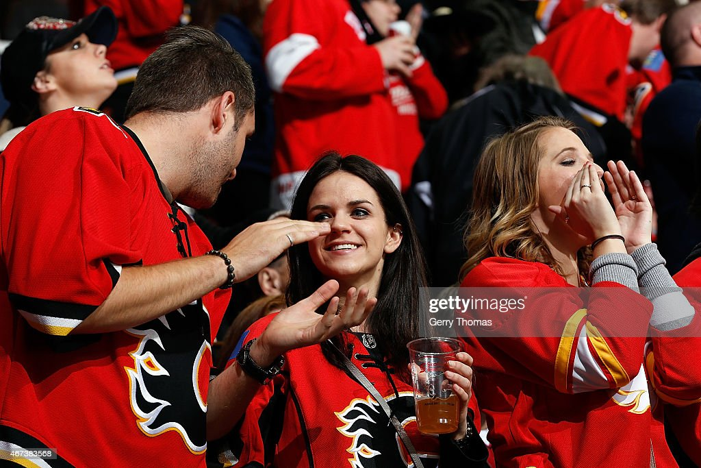 Fans of the Calgary Flames cheer after a goal against the Colorado Avalanche at Scotiabank Saddledome on March 23, 2015 in Calgary, Alberta, Canada.