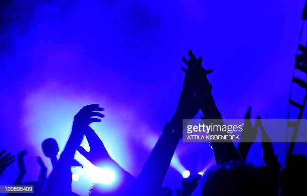 Fans of the 'Chemical Brothers' band, a Grammy award-winning British electronic music duo comprising Tom Rowlands and Ed Simons, applaud in front of...