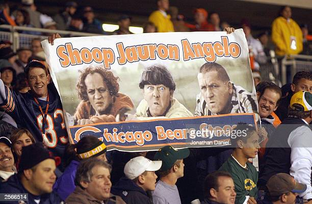 Fans of the Chicago Bears hold up a Three Stooges sign to show their unhappiness with the performance of offensive coordinator John Shoop as Larry...