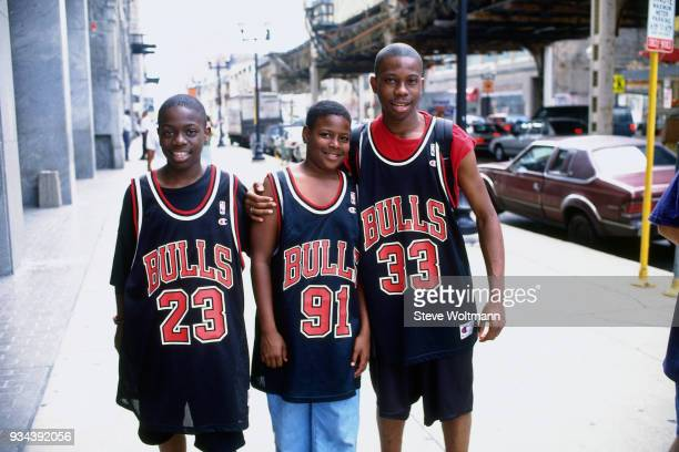 Fans of the Chicago Bulls celebrate at the Bulls 1996 NBA Championship parade on June 18 1996 in Chicago Illinois NOTE TO USER User expressly...