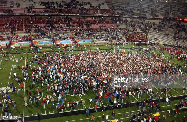 Fans of the Cincinnati Bearcats celebrate on the field after the Cincinnati defeated the Rutgers Scarlet Knights 30-11 on November 18, 2006 at...