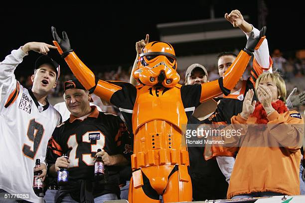 Fans of the Cincinnati Bengals dressed in costume support their team during the game against the Denver Broncos on October 25 2004 at Paul Brown...