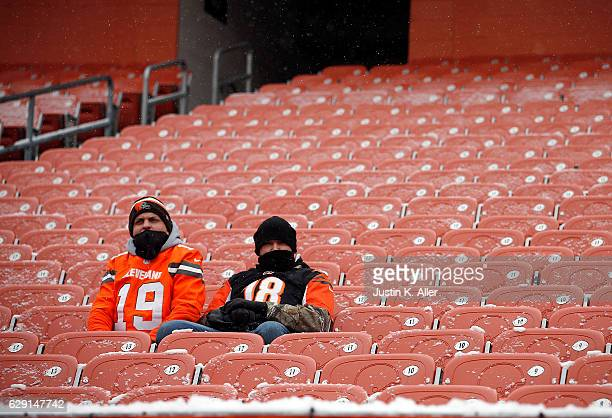 Fans of the Cleveland Browns and the Cincinnati Bengals sit together before the game at Cleveland Browns Stadium on December 11 2016 in Cleveland Ohio