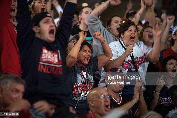 Fans of the Cleveland Indians cheer as they watch the big screen outside of Progressive Field during game 7 of the World Series between the Cleveland...