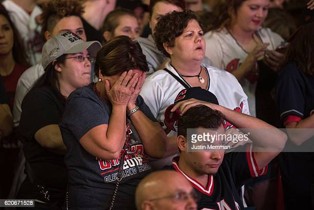 Fans of the Cleveland Indians react as they watch the big screen outside of Progressive Field during game 7 of the World Series between the Cleveland...